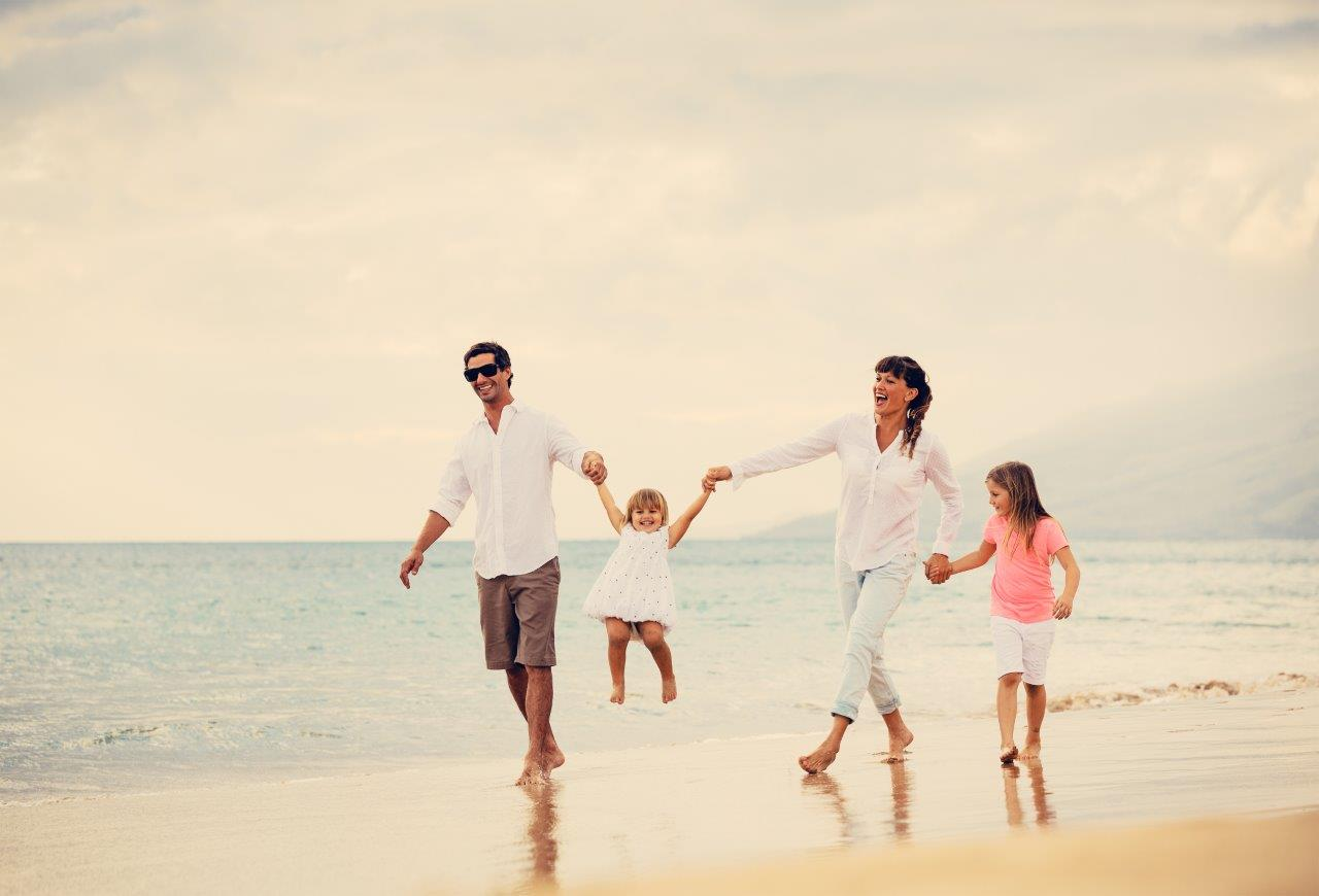Happy Young Family on Beach